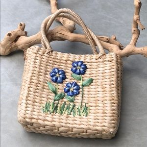 Raffia top handle bag with flower detail